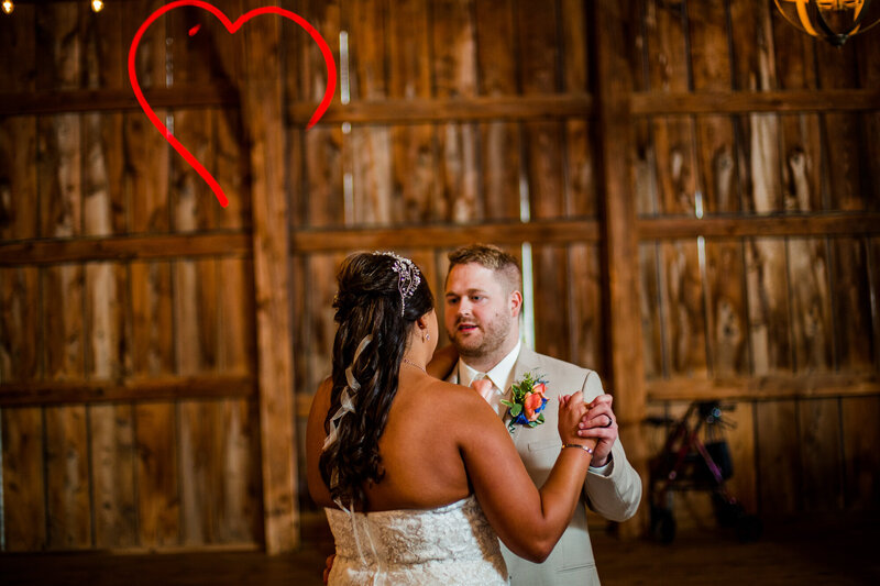 Bride and groom share first dance at Port Farms wedding reception
