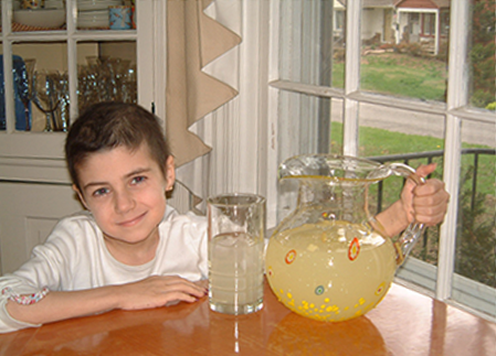 a photo of Alex from Alex's lemonade stand foundation with a pitcher of lemonade