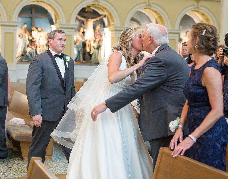 Bride kisses her father at St. Patrick's Church wedding