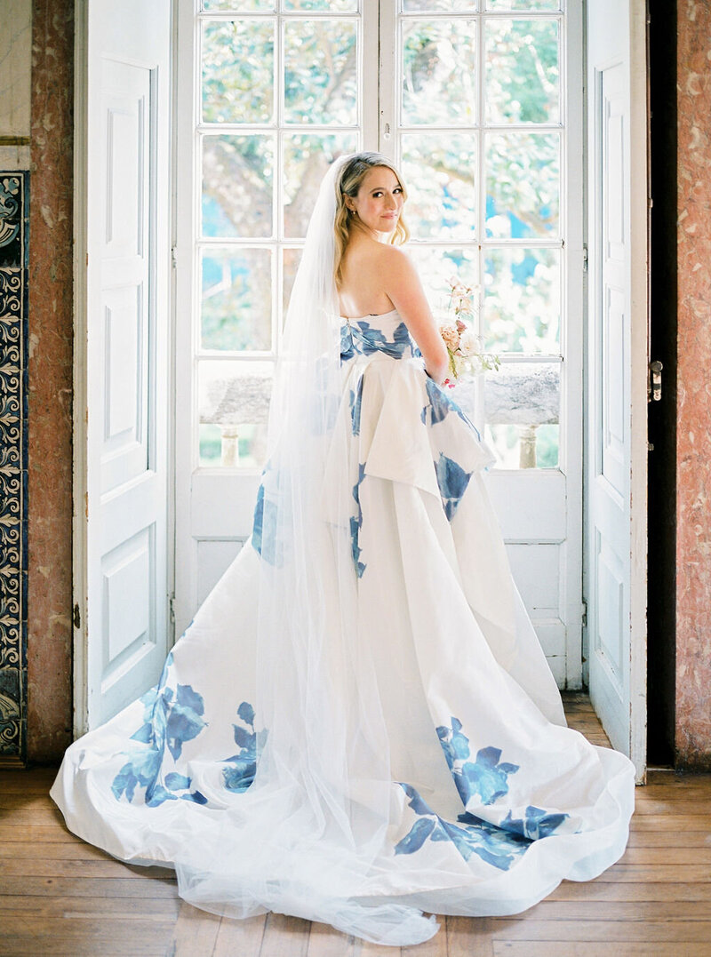 Beautiful Bride in a Monique Lhuillier dress just before her wedding ceremony in a 17th century Portuguese Palace by Sofia Nascimento Studios