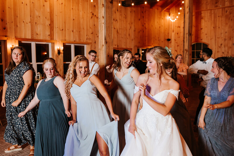Bride dancing with wedding guests at The Barn at Timber Creek