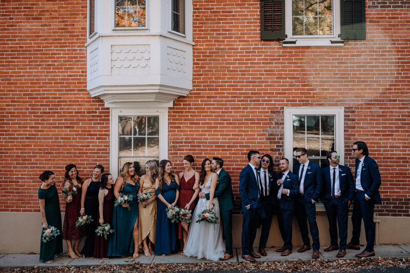 bride and groom surrounded by bridal party