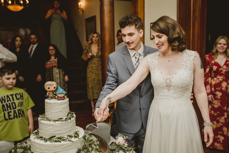 Alissa and her groom cut their wedding cake during their reception in Nashville, Tennessee.