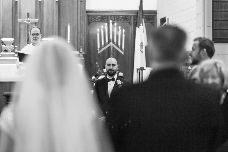 groom sees bride at trinity lutheran church port huron wedding