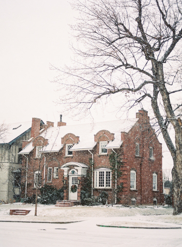 charming brick home covered in snow in denver