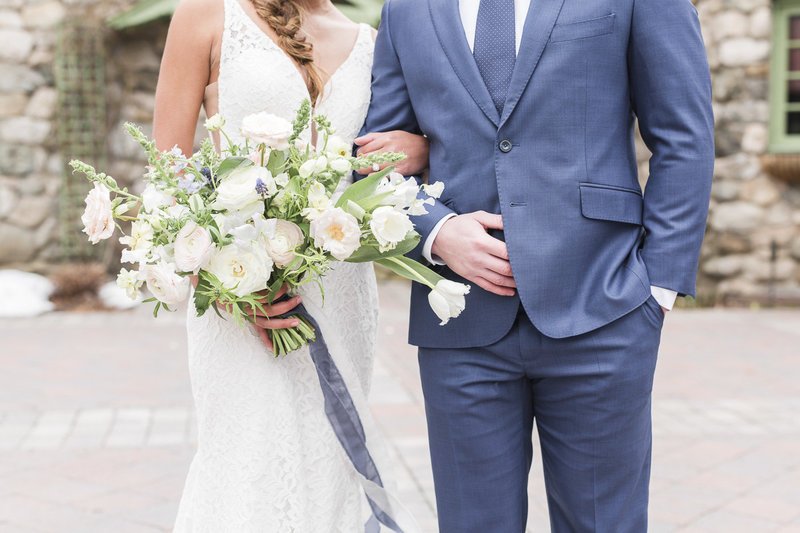 Bride and Groom connecting and holding flowers