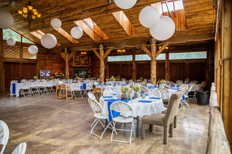 Blue and white wedding reception decor inside barn at Mountain Virew Ranch Wedgewood Weddings