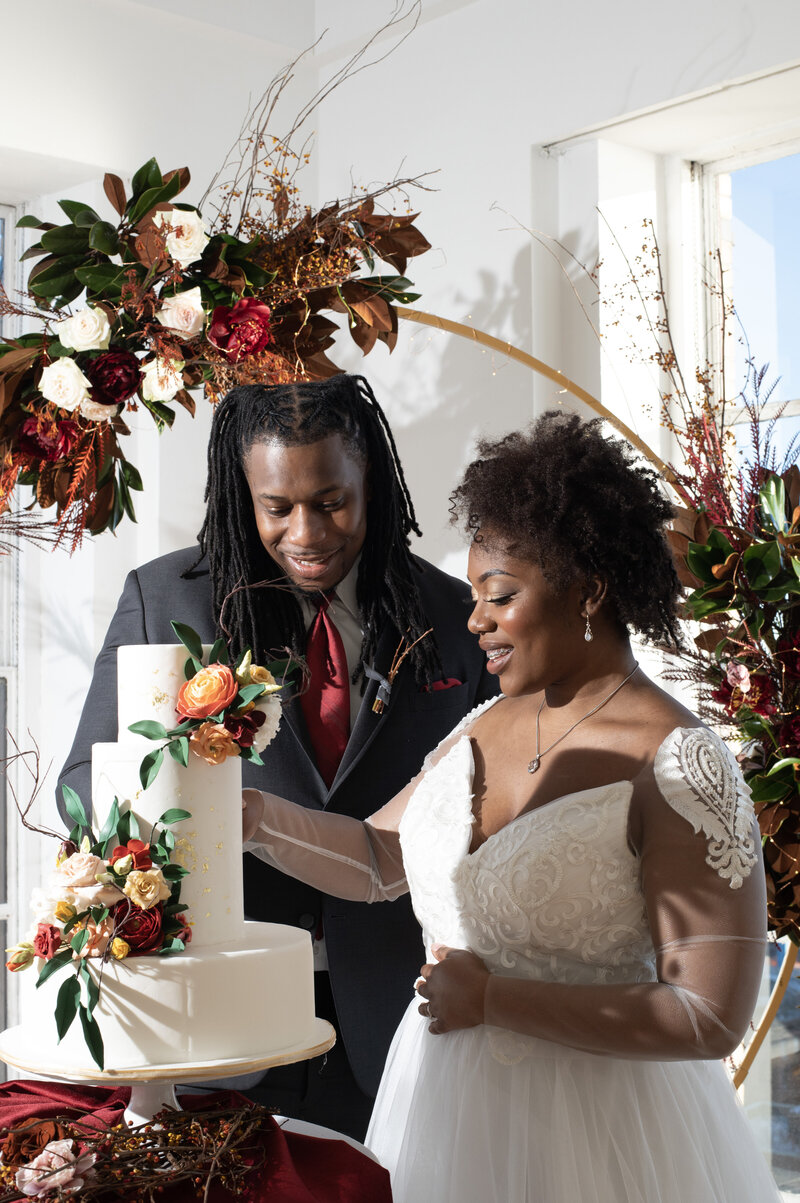 Toni and Dre were all smiles cutting this gorgeous cake for our intimate wedding styled shoot