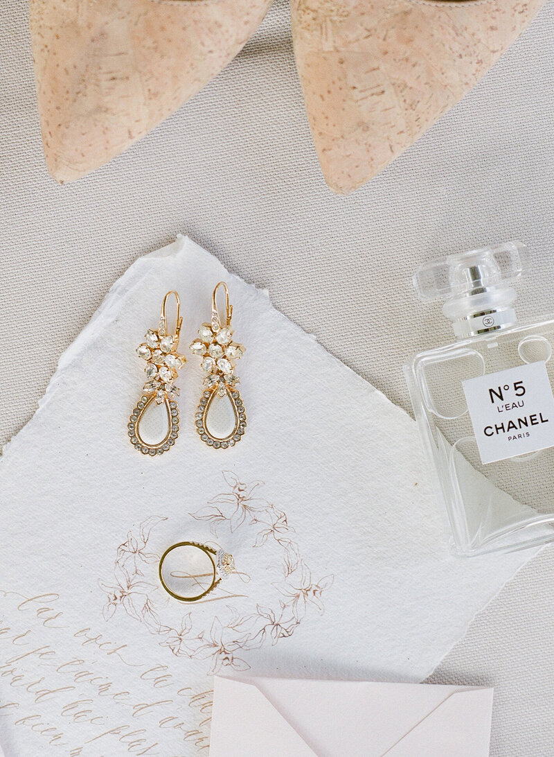 Earrings, perfume, shoes and rings, wedding details