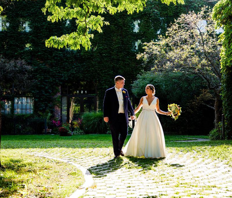 Bride and groom walking through Modern Tool Square in Erie, PA