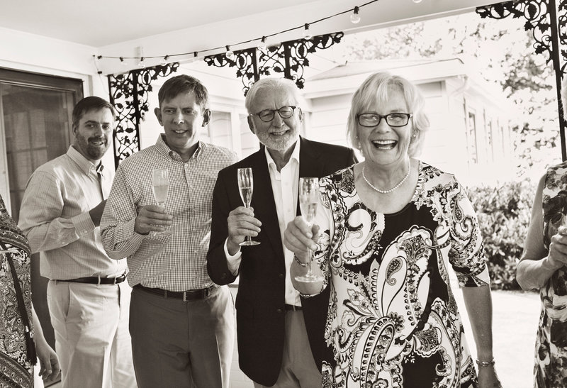 Family toasting at event
