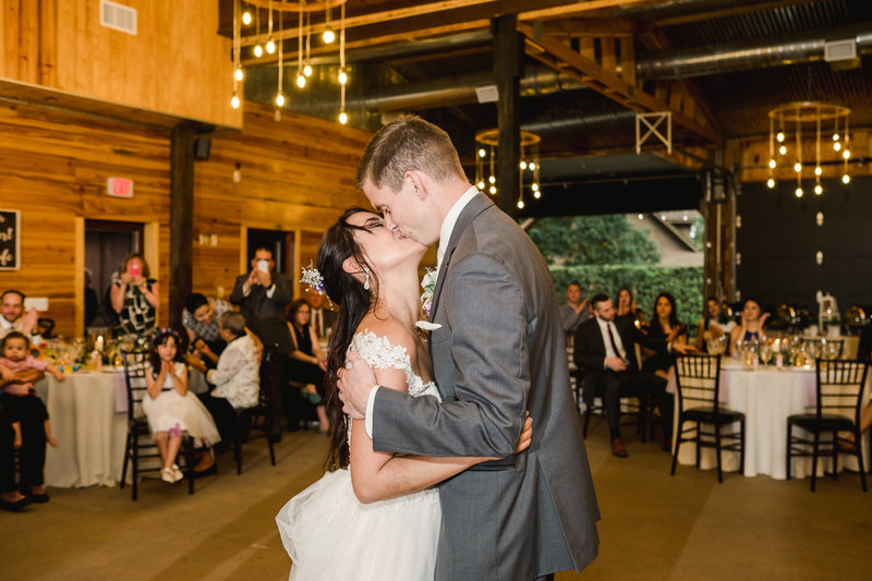 couple intimately embracing at their Club Lake Plantation Wedding reception