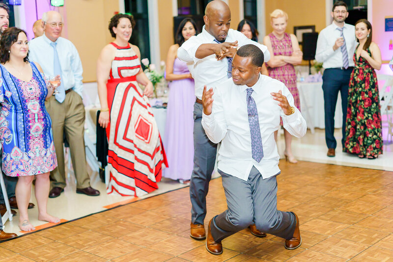 Groomsmen laughing and dancing at New Hampshire wedding