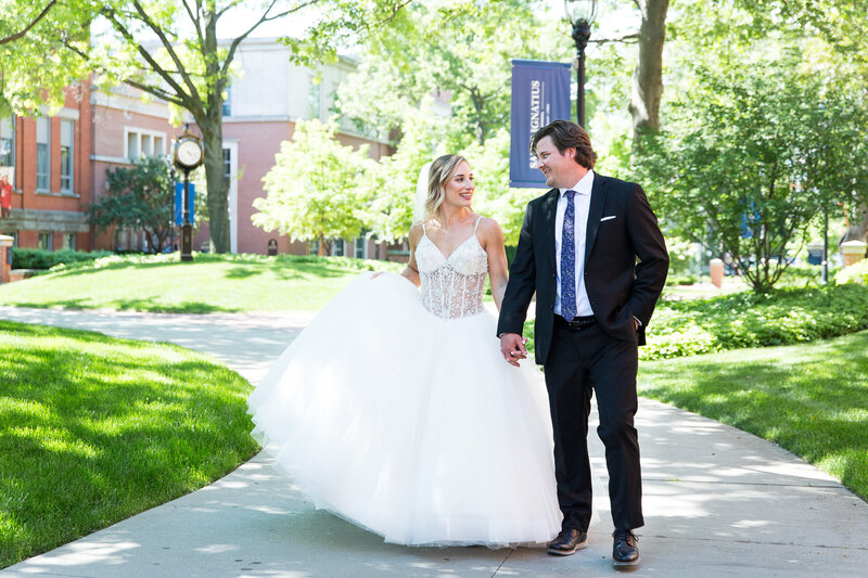 bride and groom walking at st. Ignatius school cleveland