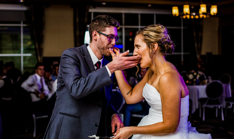 Couple feeds each other cake at Sheraton Erie Bayfront Hotel wedding