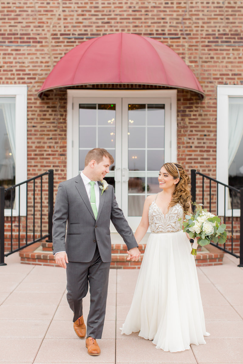 Bride and groom walking at Molly Pitcher Inn wedding