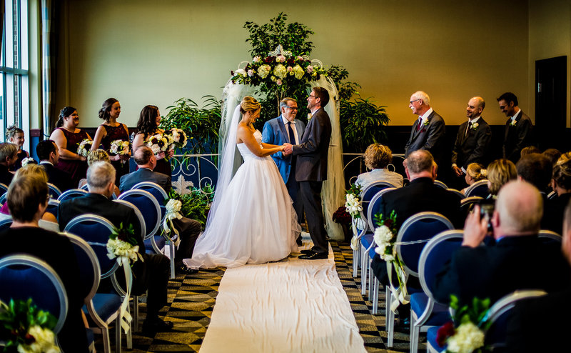 Bride and groom laughing during vows at Sheraton Erie Bayfront Hotel wedding ceremony