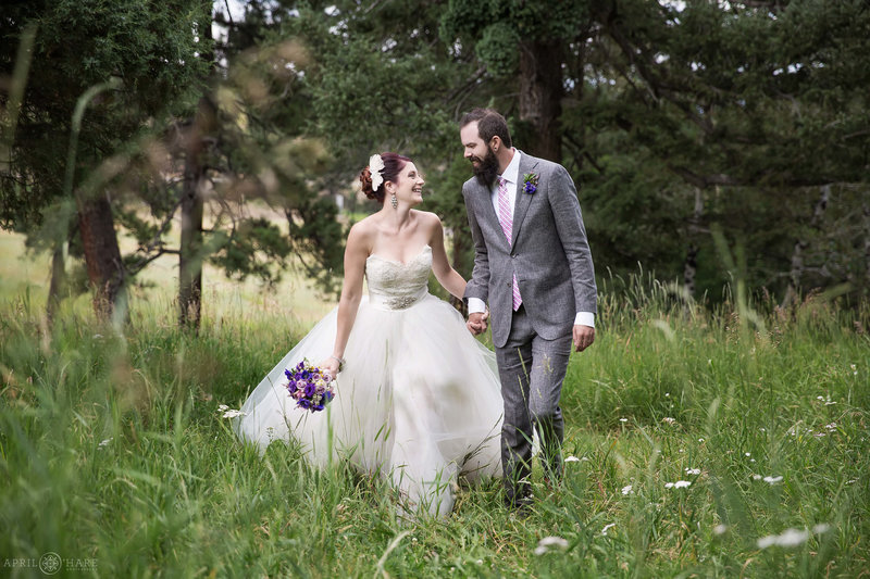 Cute couple walks through the forest at The Pines at Genesee