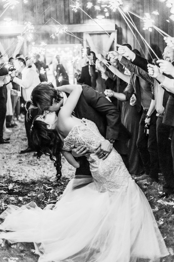 couple kissing during sparkler exit at great marsh estate wedding in northern virginia by costola photography