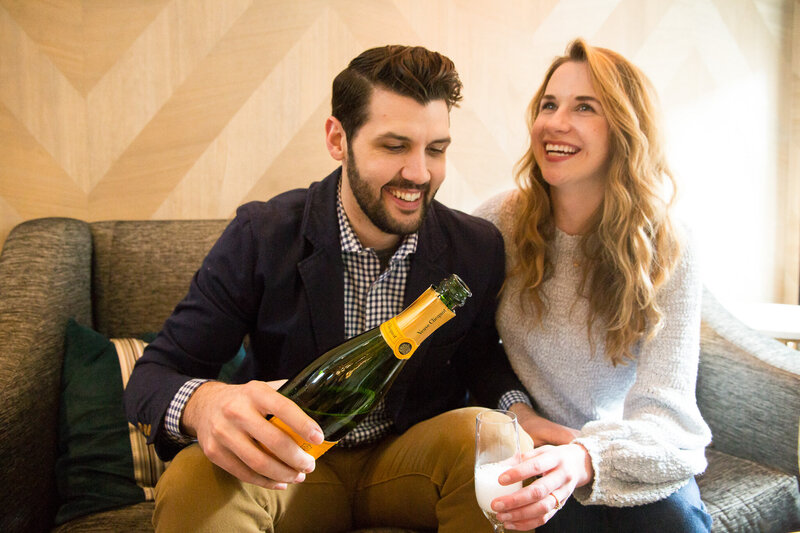 couple pouring champagne celebrating proposal at londonhouse chicago
