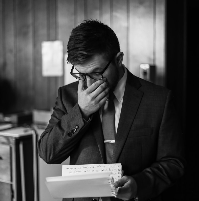 Groom wipes tears away as he read letter from his bride before their Blessed sacrament Church wedding