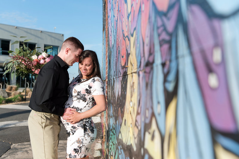 on location lifestyle maternity session on the boardwalk in asbury park