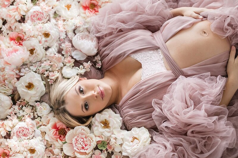 maternity photographer orlando floral bed