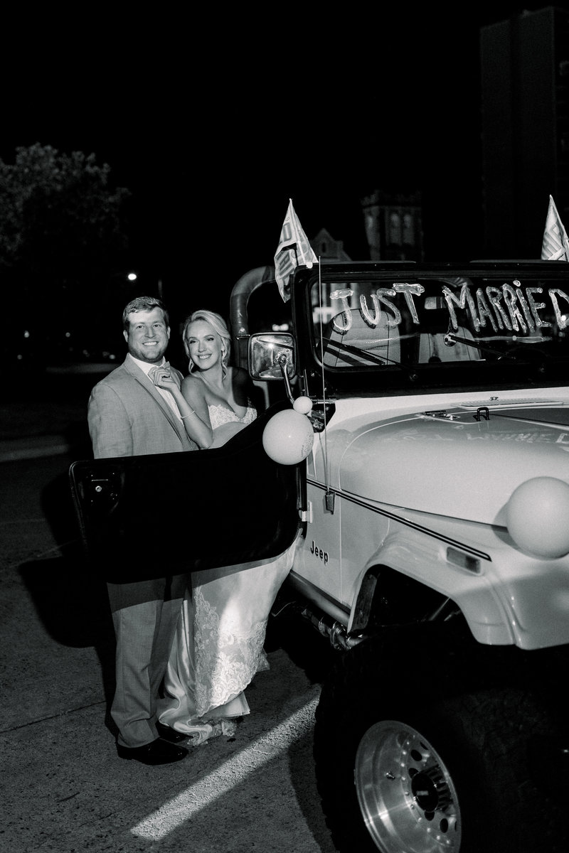 Virginia Wedding Photographer, black and white of getaway car with bride and groom