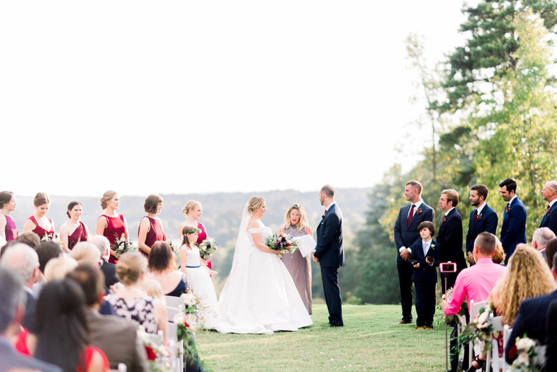 bride and groom during the wedding ceremony overlooking the town at foxhall resort by atlanta wedding photographer lane albers photography