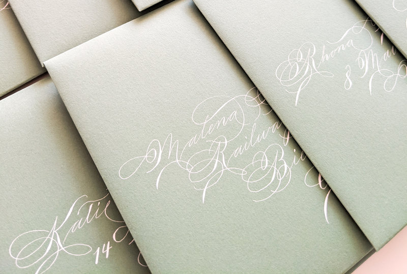 White calligraphy on light green envelopes