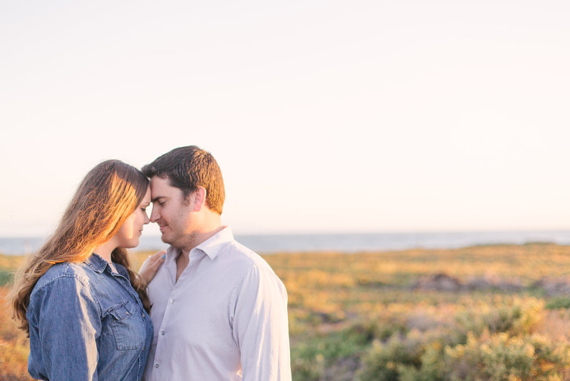 Bride and groom look at each other during  engagement shoot at UCSB