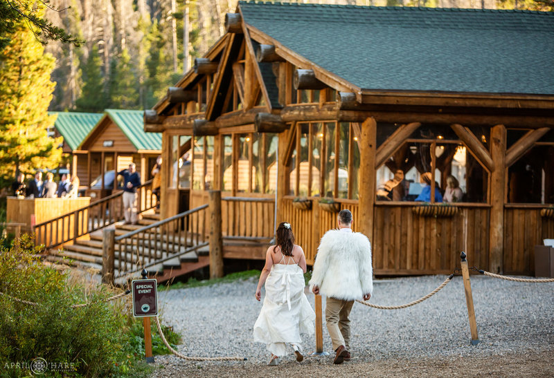 Bride and groom walk back to wedding reception at Piney River Ranch