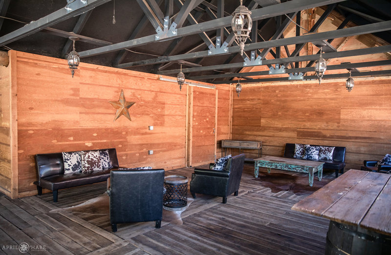 Cocktail lounge area under covered deck at Piney River Ranch