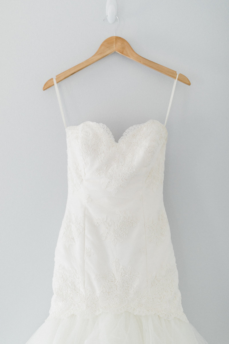 horsehair wedding dress hanging on wooden hanger