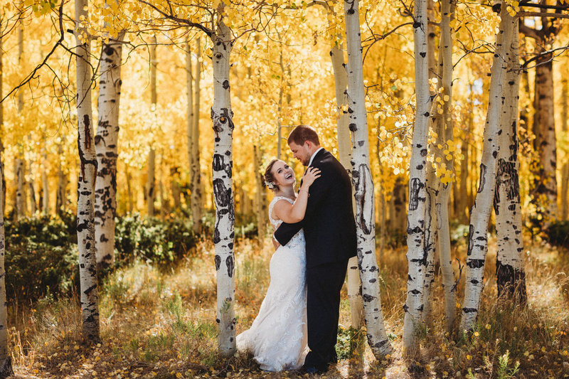 couple embraces in aspen trees after getting married in granby colorado