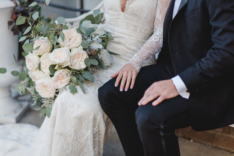 Story's Buliding Toronto Wedding Couple Sitting Bridal Bouquet Love Jacqueline James Photography