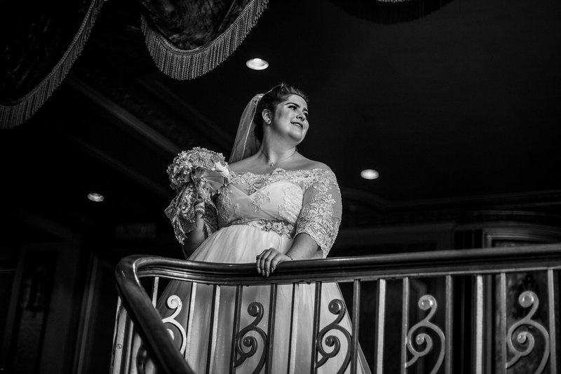 Bride standing at the top of the Grand Staircase at the Warner Theatre