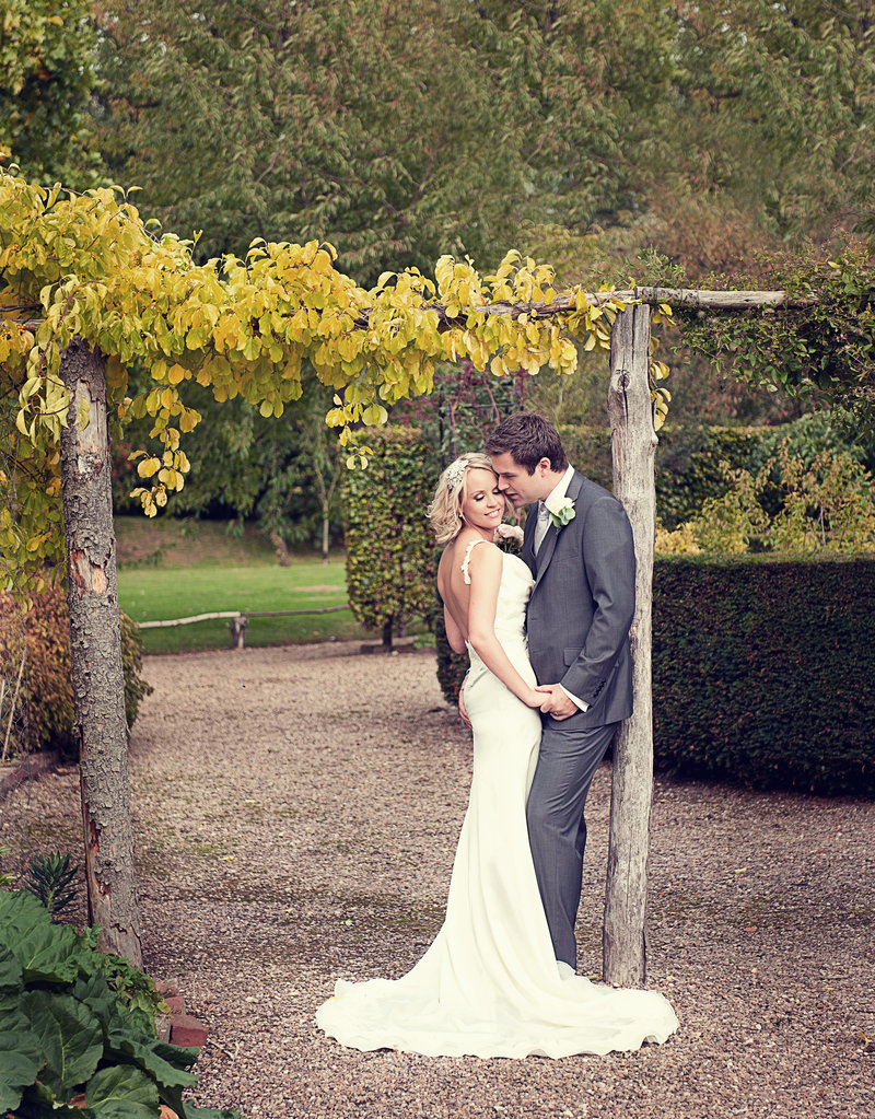 Beautiful wedding couple  embrace at Hodsock Priory