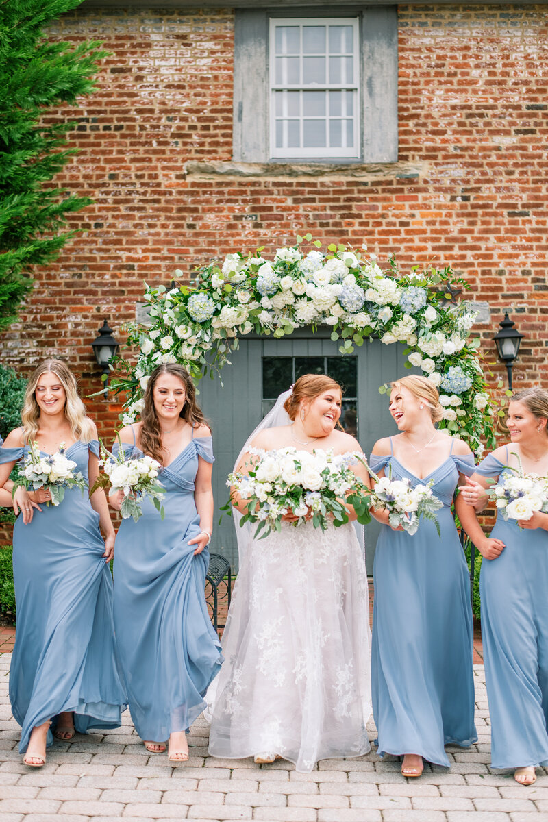 Bride and bridesmaids with blue and white bouquets in Leesburg, VA