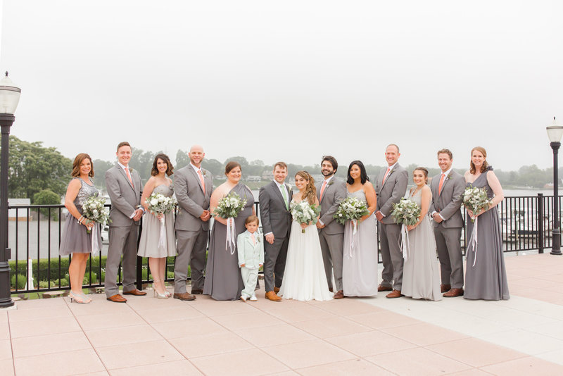 Bridal party wearing gray and green