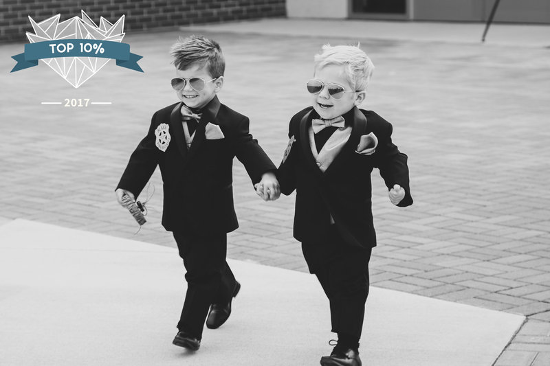 Ring bearers dressed in aviators with ring security badges