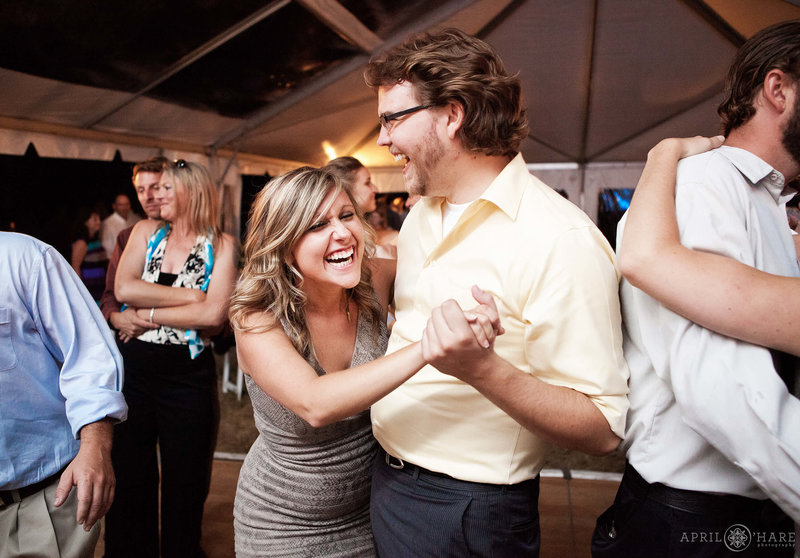Dance-Floor-Wedding-Reception-in-Tent-at-Heritage-Cabin-Barn-at-Catamount-Ranch-in-Steamboat-Springs-CO