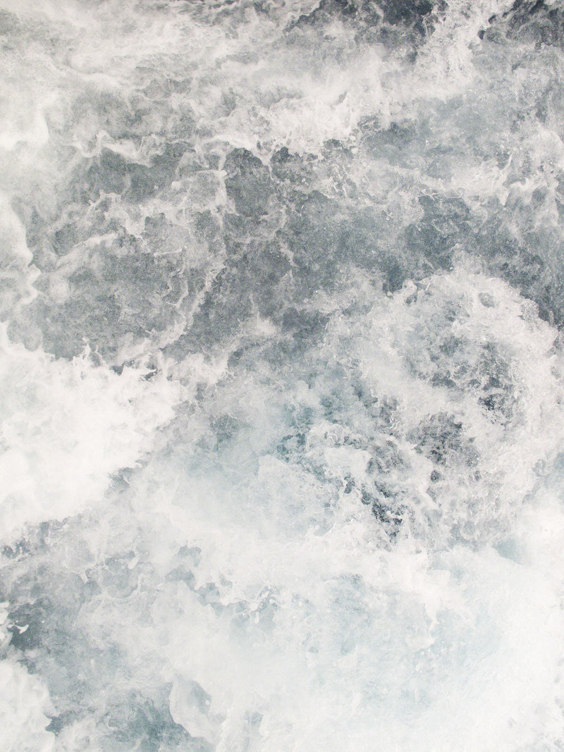 Detail image of waves crashing in the deep blue sea