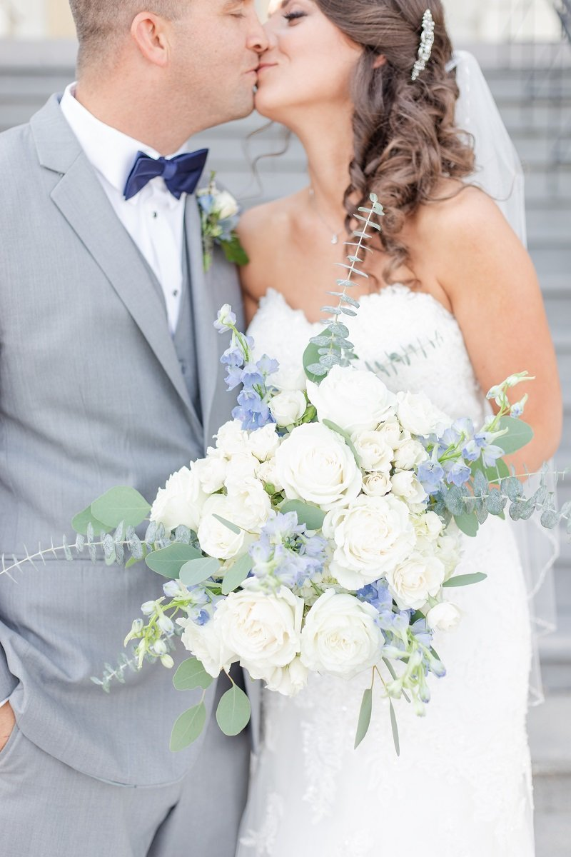Val and Ryan Kissing with White and Blue Floral Bouquet