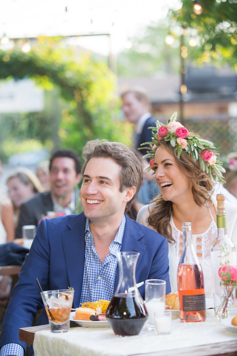 Smiling couple at toasts. Wine country dinner party by Jenny Schneider Events at Ad hoc in Yontville, California.