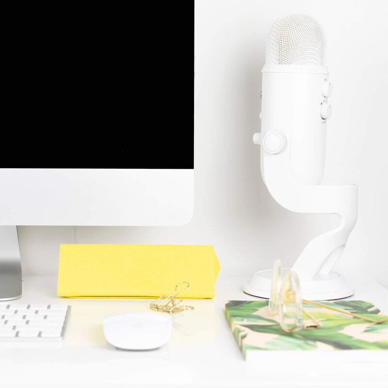 Desktop with Podcast Microphone and Tropical Office Supplies