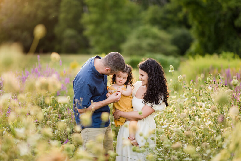 family embracing and playing during family photography session