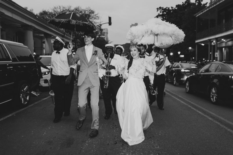 High End Bride and Groom doing their Second Line in the French Quarter