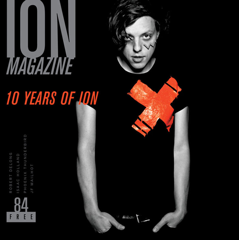 Magazine cover Santa Monica publication ION featuring musician Robert Delong standing against black backdrop hands in his pockets black and white image red text