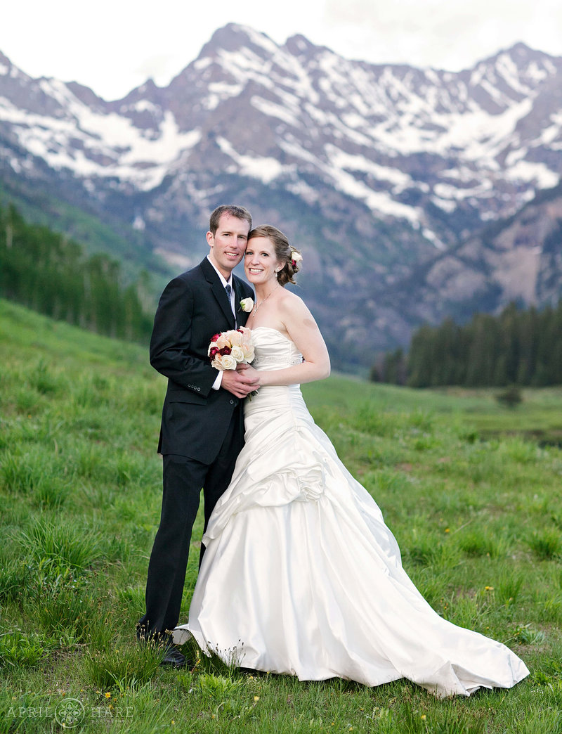 Bride and Groom portrait at Sunset with Mountain Views in Vail at Piney River Ranch